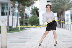 Image of a businesswoman pulling on a rope Royalty Free Stock Images