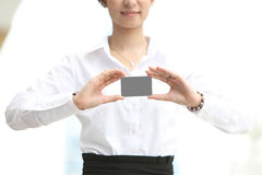 Image Businesswoman showing and handing a blank business card - clippi Stock Image