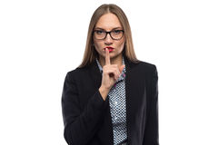 Image of businesswoman showing silence in glasses Royalty Free Stock Photos