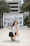 Image of a businesswoman squatting Royalty Free Stock Photos
