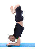 Image of calm man doing yoga handstand Stock Photo
