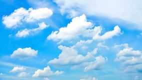 Beautiful blue sky and white fluffy clouds. Natural background. Concepts of freedom, peaceful, heaven, natural phenomenon, etc. This image can be use as stock photography