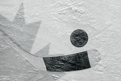 The image of the Canadian flag and hockey puck with the stick Stock Images