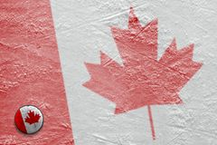 Image of the Canadian flag on ice with a washer Stock Photos