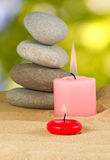 Image of candles and stones on sand close up Stock Image