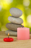 Image of candles and stones on sand closeup Royalty Free Stock Images