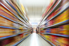 The image of the cart pushed past the store shelves Royalty Free Stock Images