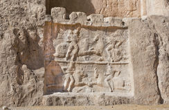 Image carved into the stone of the glorious victories of the Persian rulers. IRAN: Image carved into the stone of the glorious victories of the Persian rulers Royalty Free Stock Images