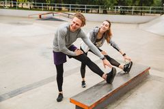 Image of caucasian sporty couple man and woman 20s in sportswear Stock Images