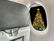 image of  chair on airplane and Christmas tree Royalty Free Stock Photos