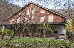 Chalet. Image of a chalet in a forest in autumn Stock Images