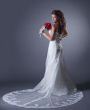 Image of charming bride posing in elegant dress Royalty Free Stock Photography