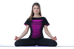 Image of charming brunette meditates in studio Royalty Free Stock Photography
