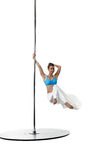 Image of charming female dancer spinning on pole Royalty Free Stock Photography