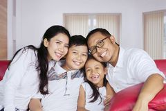 Cheerful family sitting together at home Royalty Free Stock Images