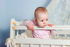 Baby in children's to a bed Royalty Free Stock Photo