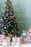 Image of decorated Christmas tree with gift. stock image