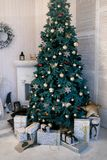 Image of decorated Christmas tree with gift. stock photos