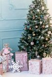 Image of decorated Christmas tree with gift. royalty free stock image
