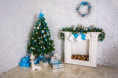 Image of chimney and decorated xmas tree. With gift Royalty Free Stock Photography