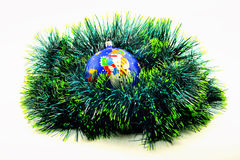 image. Christmas decorations. blue ball on green garlan Royalty Free Stock Photography