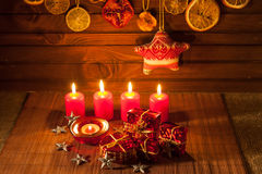Image of Christmas decorations, candles, gifts on brown background Stock Image