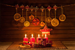 Image of Christmas decorations, candles, gifts on brown background Royalty Free Stock Photos