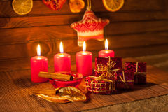 Image of Christmas decorations, candles, gifts on brown background Royalty Free Stock Photo