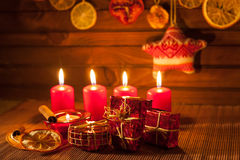 Image of Christmas decorations, candles, gifts on brown background Stock Images
