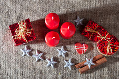 Image of Christmas decorations, candles, gifts on linen background Royalty Free Stock Photography