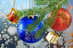Image of Christmas decorations on window frost background close-up Royalty Free Stock Photography