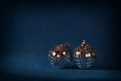 Image of christmas festive decorations on blue glitter background. retro filtered Royalty Free Stock Photo