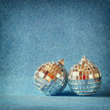 Image of christmas festive decorations on blue glitter background. retro filtered with glitter overlay. selective focus Stock Image