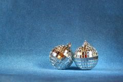 Image of christmas festive decorations on blue glitter background. retro filtered. selective focus Royalty Free Stock Photo