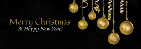 Image of christmas festive tree gold ball decoration in front of black background There is the text Happy Christmas Royalty Free Stock Photos
