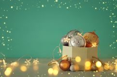 Image of christmas festive tree gold, silver and white balls decoration in the gift box. Image of christmas festive tree gold, silver and white balls decoration stock images