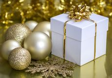 Christmas Gift Box and Baubles. Image of a Christmas gift box and Christmas baubles Royalty Free Stock Images
