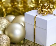 Christmas Gift Box and Baubles. Image of a Christmas gift box and Christmas baubles Stock Photo