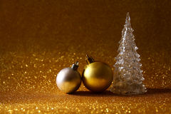 Image of christmas glowing festive tree and ball decorations Royalty Free Stock Photos