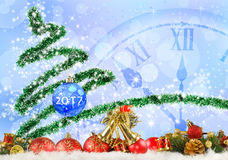 Image of Christmas tree and clock close up.  Royalty Free Stock Image