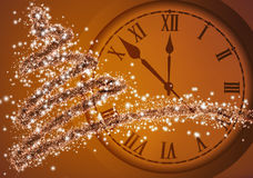Image of Christmas tree and clock close up. 