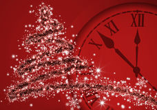Image of Christmas tree and clock close up.  Royalty Free Stock Images