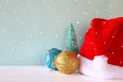 Image of christmas trees next to santa hat. Royalty Free Stock Photo