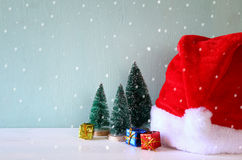 Image of christmas trees next to santa hat. Stock Images