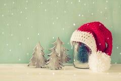 Image of christmas trees next to santa hat. Royalty Free Stock Image