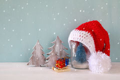Image of christmas trees next to santa hat. Stock Photography
