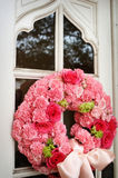 An image of church doors with Wedding flowers on i. T Stock Photos