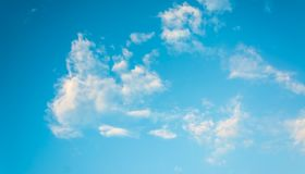 Image of clear blue sky and white clouds on day time for backgro. Und usage Royalty Free Stock Photo