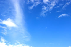 Image of clear blue sky and white clouds on day time for background usage Stock Images