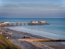 Fishing boats and Cromer Pier Royalty Free Stock Photos